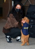 Bella Hadid flashes her taut tummy and plays with a NYPD puppy while waiting for a rapid COVID-19 test result in New York City