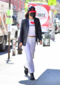 Bella Hadid goes shopping and brings flowers for Gigi's 26th birthday in New York City