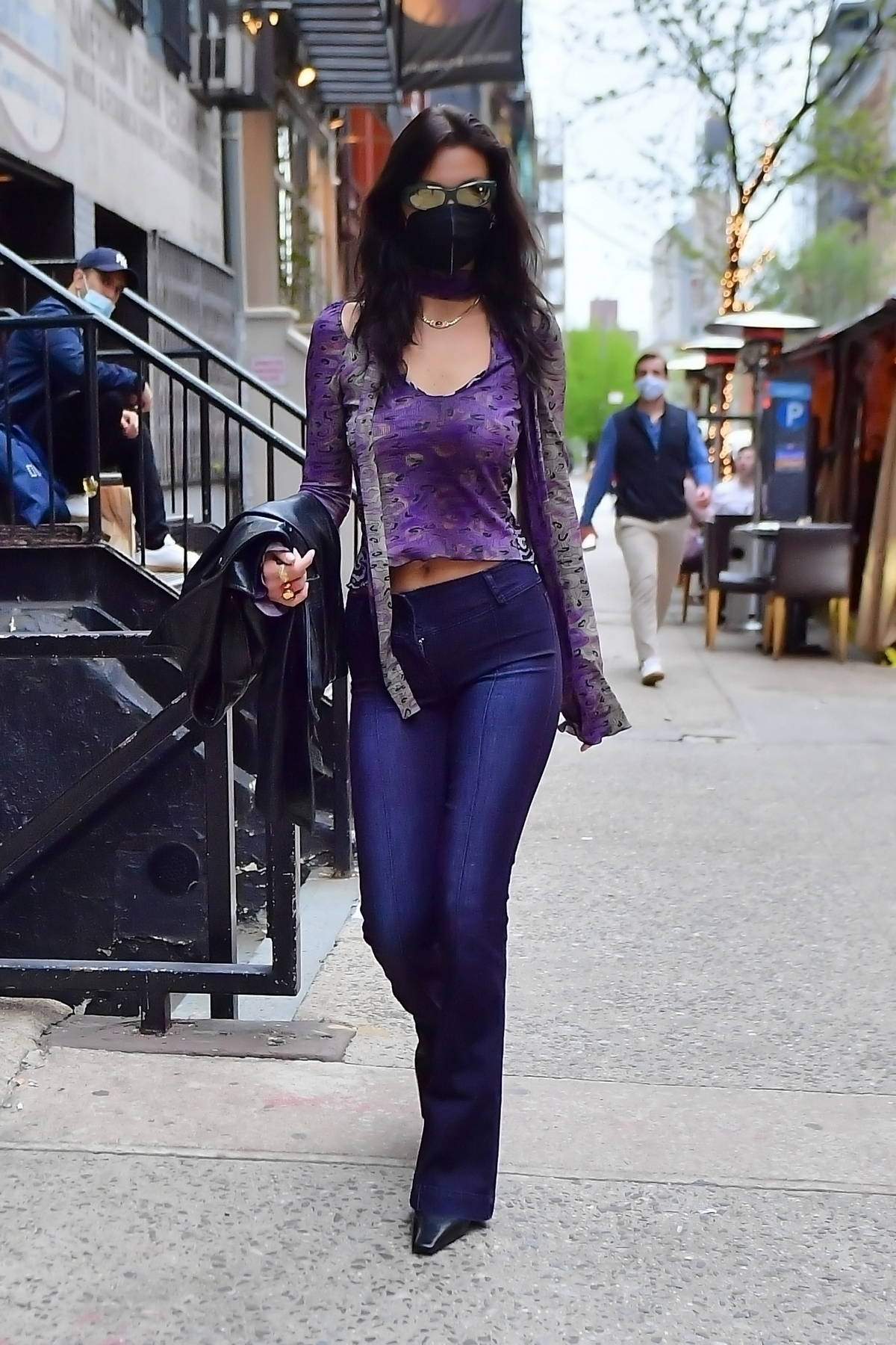 Bella Hadid looks striking in purple leaving sister Gigi's apartment headed to Zero Bond in New York City