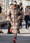 Bella Hadid looks stylish in a full-length puffer jacket while on set for a photoshoot for Michael Kors FW/21 in New York City