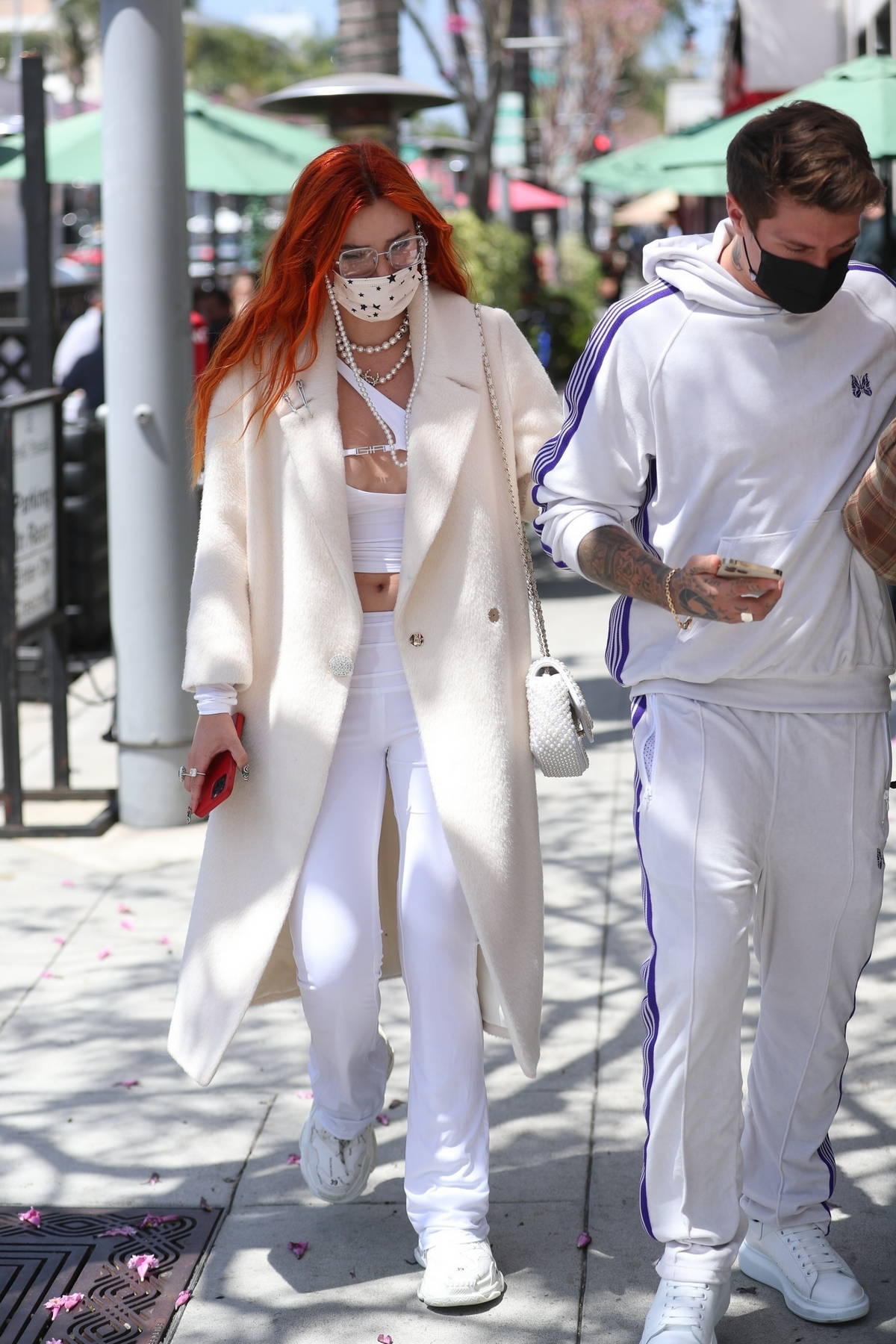 Bella Thorne and Benjamin Mascolo donned matching white ensemble during a lunch outing in Beverly Hills, California