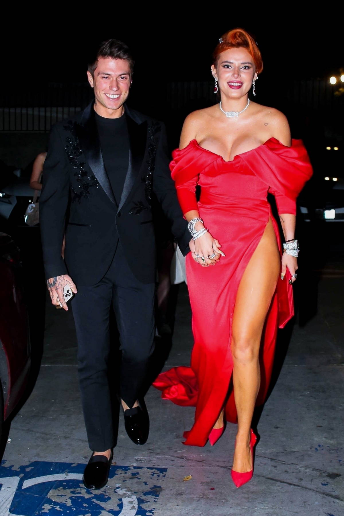 Bella Thorne looks stunning in a side-slit red gown for her engagement party with Benjamin Mascolo in West Hollywood, California