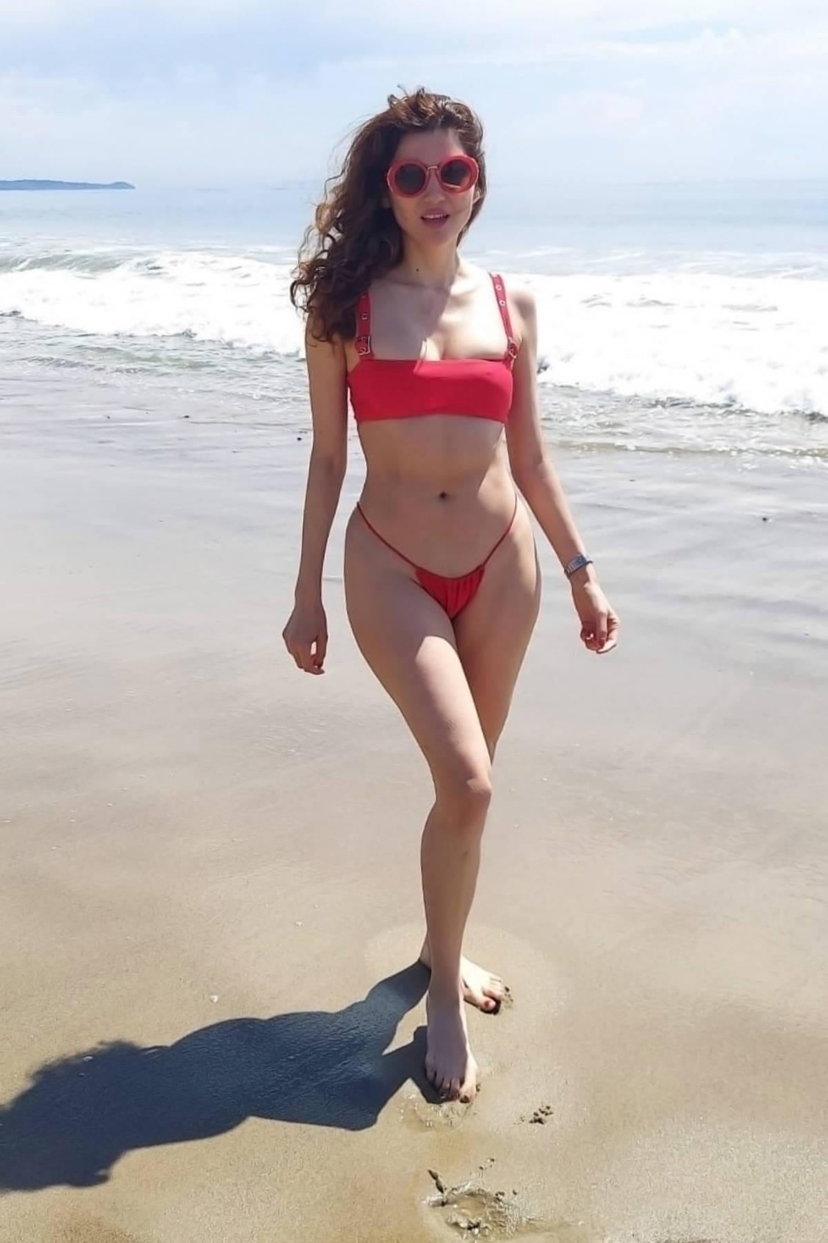 Blanca Blanco slips into a red bikini as she hits the beach in Malibu, California