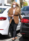 Britney Spears wears a brown blazer and black skin-tight jeans during a shopping trip in Malibu, California