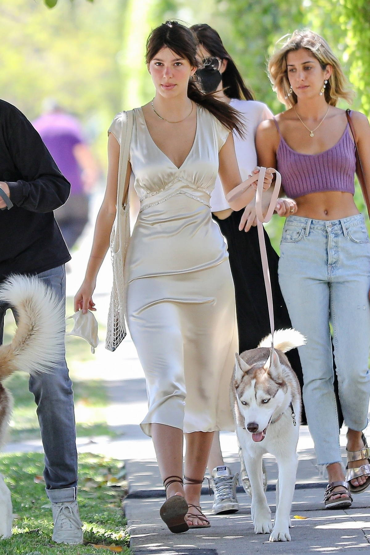 Camila Morrone looks gorgeous in a satin dress while out for walk with her mom and a few friends in Santa Monica, California
