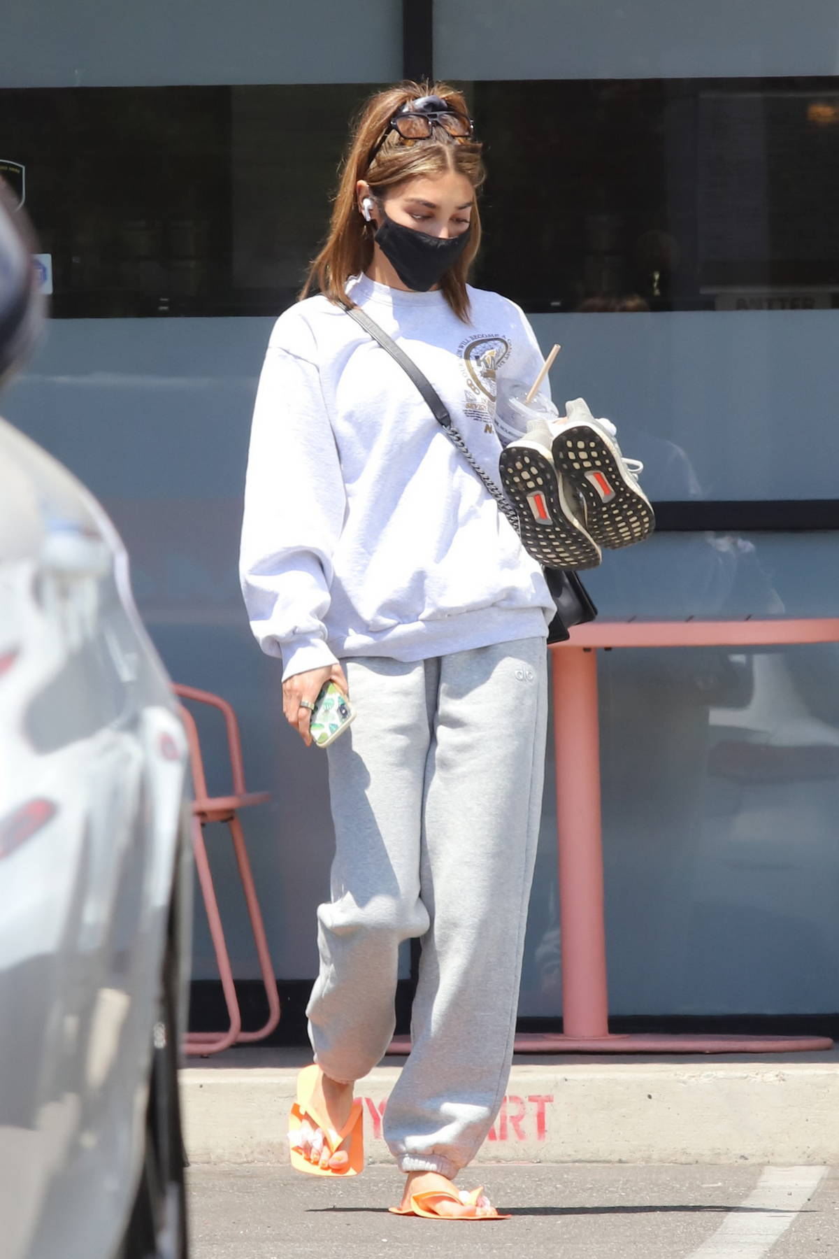 Chantel Jeffries seen carrying her shoes while leaving a nail salon in West Hollywood, California