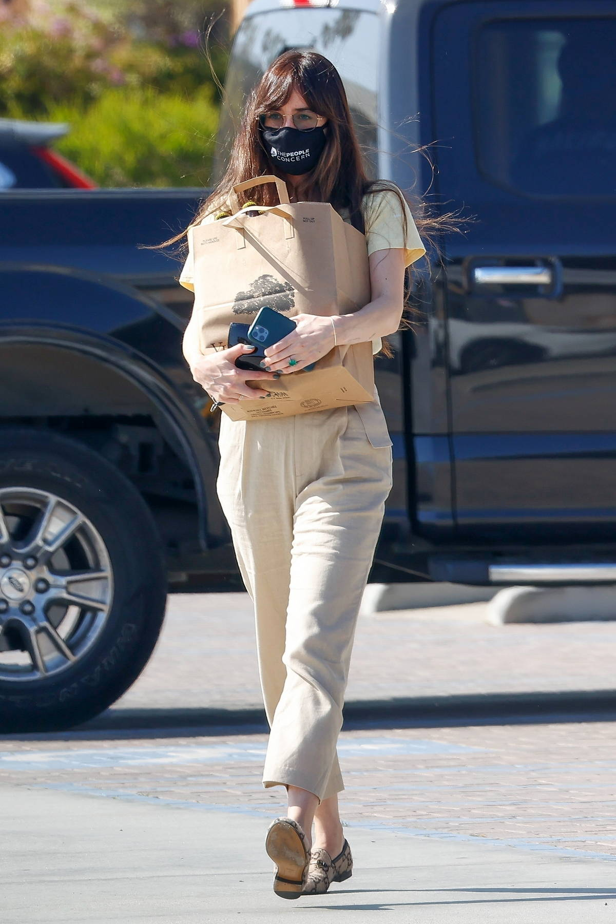 Dakota Johnson picks up some groceries before grabbing herself a coffee while out in Malibu, California