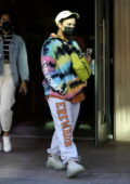 Demi Lovato wears a tie-dye hoodie with sweatpants as she leaves a building in Beverly Hills, California