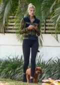 Devon Windsor steps out for a morning walk with her pup in Coral Gables, Florida