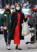 Dianna Agron looks stylish in a red dress and black overcoat as she goes shopping with friends in New York City