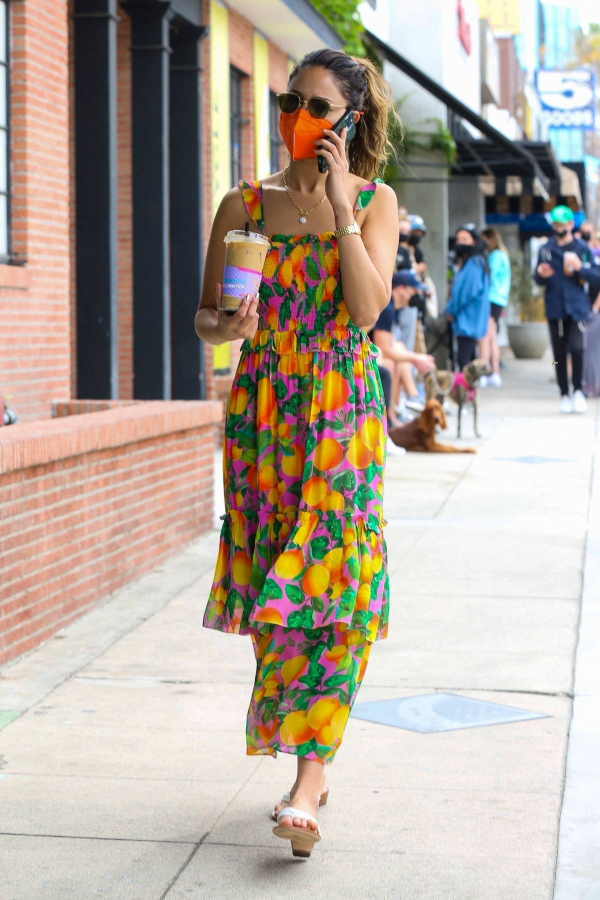 Eiza Gonzalez looks pretty in a colorful floral dress during her morning coffee run in West Hollywood, California