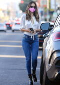Eiza Gonzalez looks stylish in a white satin shirt and skin-tight jeans for a lunch outing in West Hollywood, California