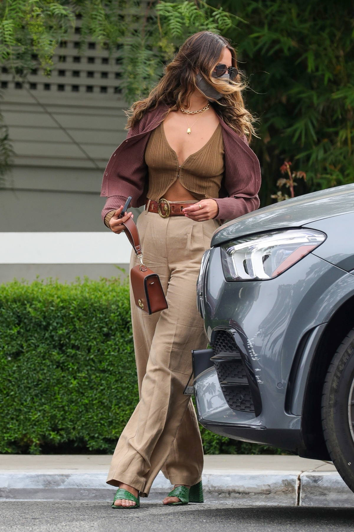 Eiza Gonzalez rocks a stylish crop top with a cardigan while leaving brunch in West Hollywood, California