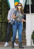 Eiza Gonzalez wears 'Def Leppard' tee and skinny jeans with combat boots while out for a lunch in West Hollywood, California
