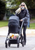 Elsa Hosk enjoys a stroll with her daughter and buys some flowers at a local Trader's Joe in Los Angeles