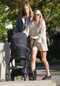 Elsa Hosk looks radiant while out for a stroll with and Tom Daly and their baby daughter in Los Angeles