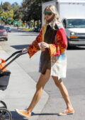 Elsa Hosk looks stylish and colorful during a coffee run with her baby daughter in Los Angeles