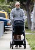 Elsa Hosk stays cozy in a fuzzy grey sweater as she takes a walk with her baby and grabs breakfast in Los Angeles