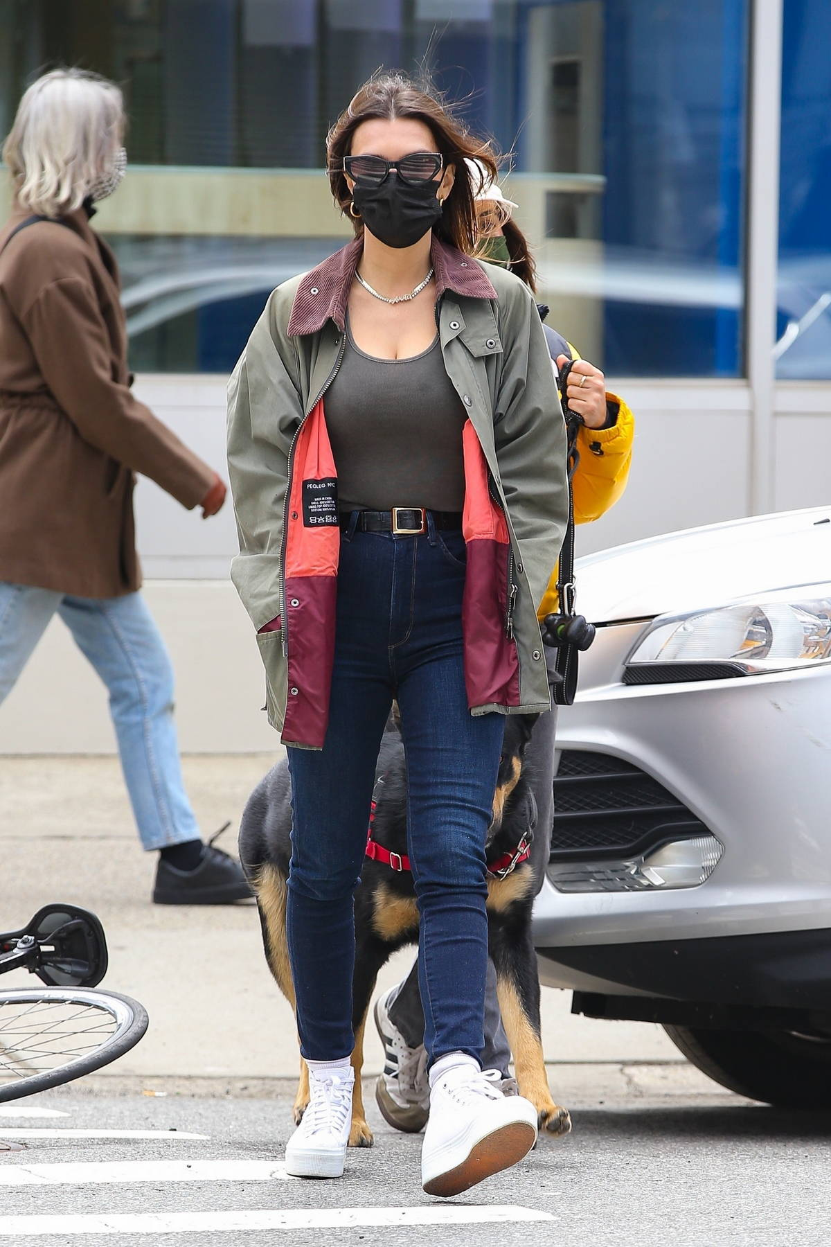 Emily Ratajkowski looks cool in skinny jeans, a tight top and jacket while out for a stroll with friends in New York City