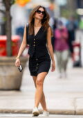 Emily Ratajkowski looks perfect in a black vest with matching skirt as she steps out for a stroll in New York City