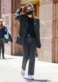 Emily Ratajkowski steps out for a stroll wearing a pinstriped suit in New York City