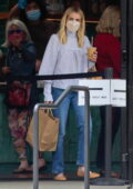Emma Roberts stops for some takeout before returning home in Los Angeles