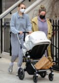 Gigi Hadid stays cozy in grey sweats as takes a her baby out for a stroll to the Washington Square Park in New York City