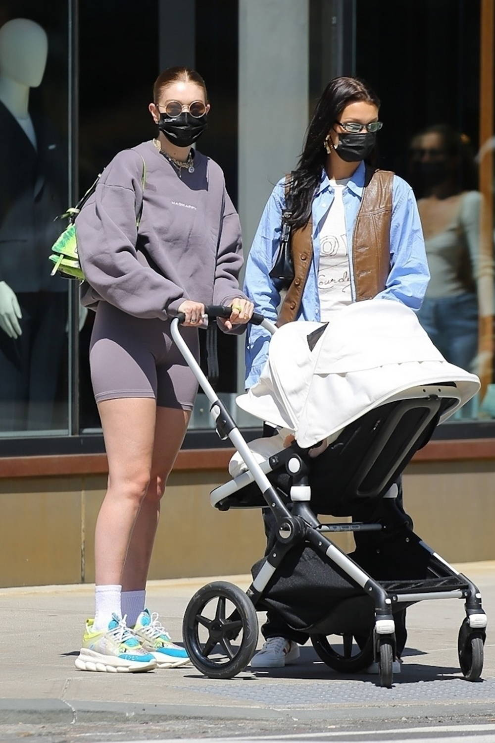 Gigi Hadid takes her daughter out for a stroll during a lunch outing with Bella Hadid in New York City