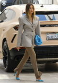 Hailey Bieber dressed for business in a plaid blazer and brown pants as she heads for a meeting in Los Angeles