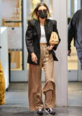 Hailey Bieber looks chic in a black blazer and wide-leg tan trousers as leaves the doctor's office in Beverly Hills, California