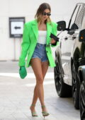Hailey Bieber puts on a leggy display in denim shorts with a neon green blazer while out for a business meeting in Beverly Hills, California