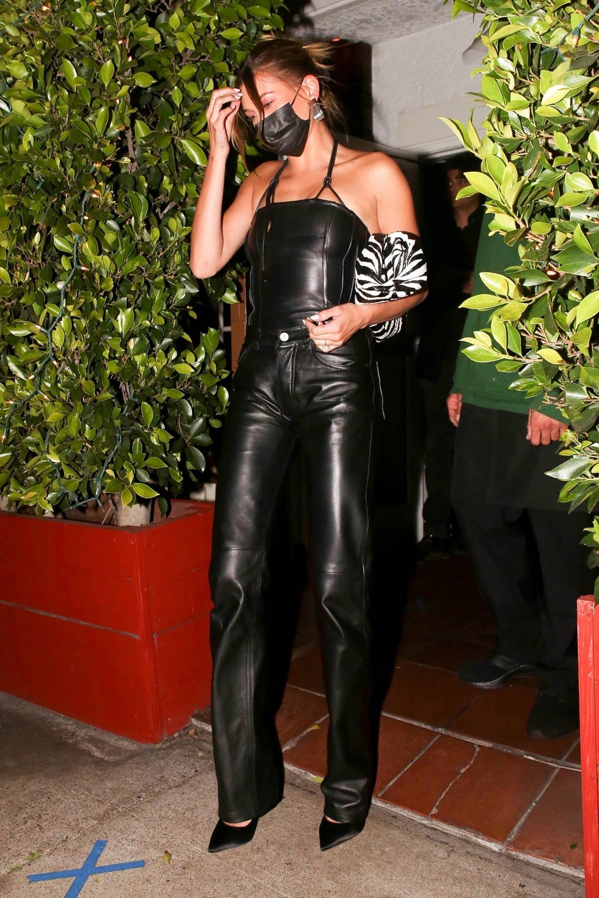 Hailey Bieber rocks an all-black leather outfit while grabbing dinner at Giorgio Baldi in Santa Monica, California
