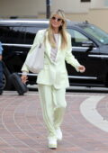 Heidi Klum dons a pastel green suit with matching sneakers as she arrives at the AGT taping in Los Angeles