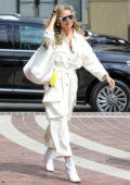 Heidi Klum dons an all-white ensemble as she arrives at the taping of America's Got Talent in Los Angeles