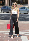 Heidi Klum poses for photos as she arrives at a taping for America's Got Talent in Pasadena, California