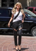 Heidi Klum rocks stylish black leather pants as she arrives at America's Got Talent taping in Los Angeles