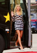 Heidi Klum stuns in a black and white checkered mini dress as she takes the red carpet during an AGT special in Los Angeles