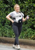 Hilary Duff straps her newborn baby to her chest while enjoying a hike with her family in Studio City, California