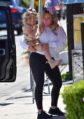 Hilary Duff wears a white sweatshirt and black leggings while running errands in Studio City, California