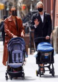 Irina Shayk and Karlie Kloss step out for a stroll with their prams at Washington Square Park in New York City
