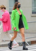Irina Shayk dazzles in a bright green blazer over a short black dress while out for a stroll in New York City