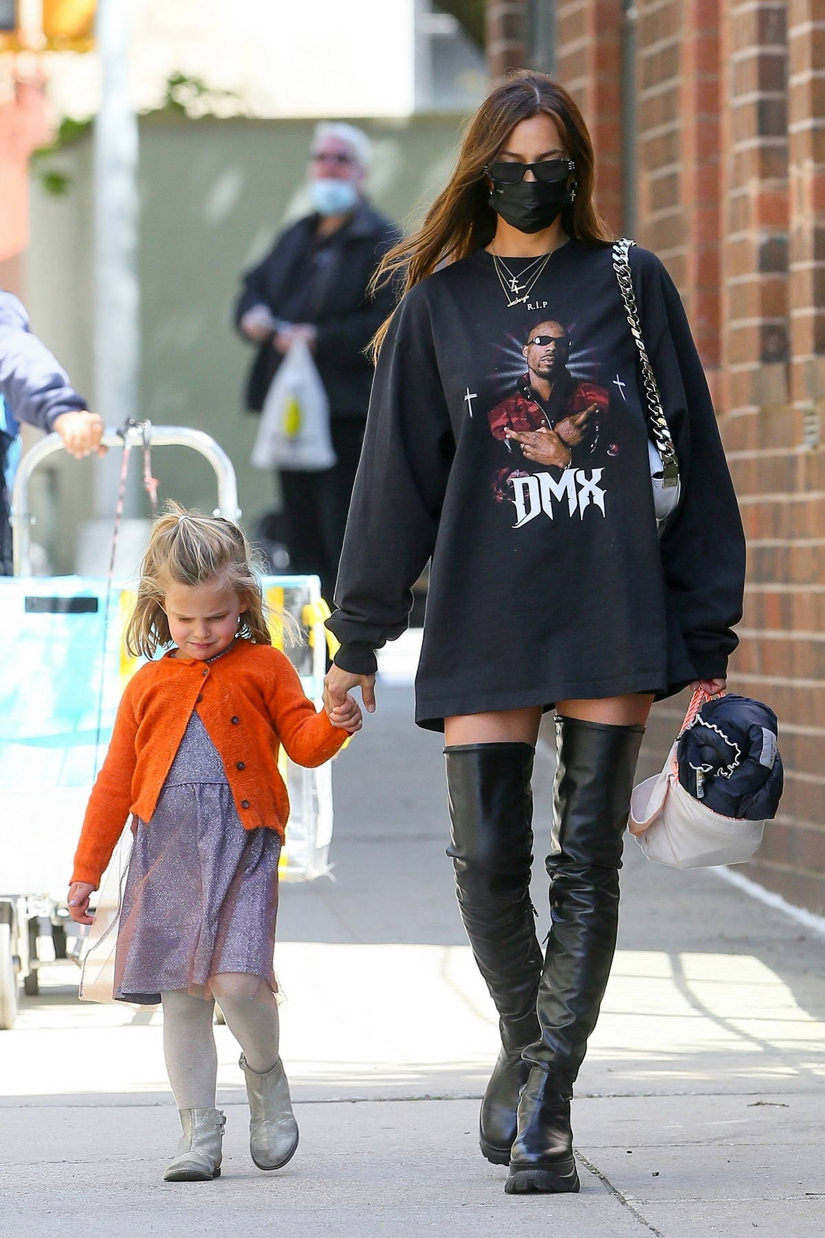 Irina Shayk dons an oversized 'DMX' sweatshirt and a pair of thigh-high boots while stepping out with her daughter in New York City