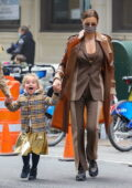 Irina Shayk keeps it chic in a brown suit as she steps out with her daughter in New York City