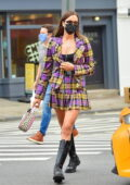 Irina Shayk looks stunning in a colorful paid mini skirt with matching blazer while out in New York City