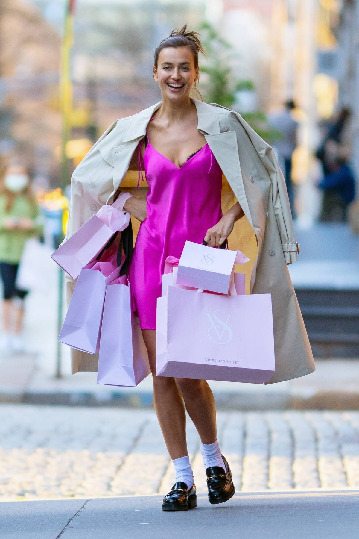 Irina Shayk looks stunning in a pink satin slip dress during a Victoria's Secret photoshoot in Tribeca, New York