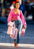 Irina Shayk poses in a hot pink corset top and jeans during a Victoria's Secret photoshoot in Tribeca, New York