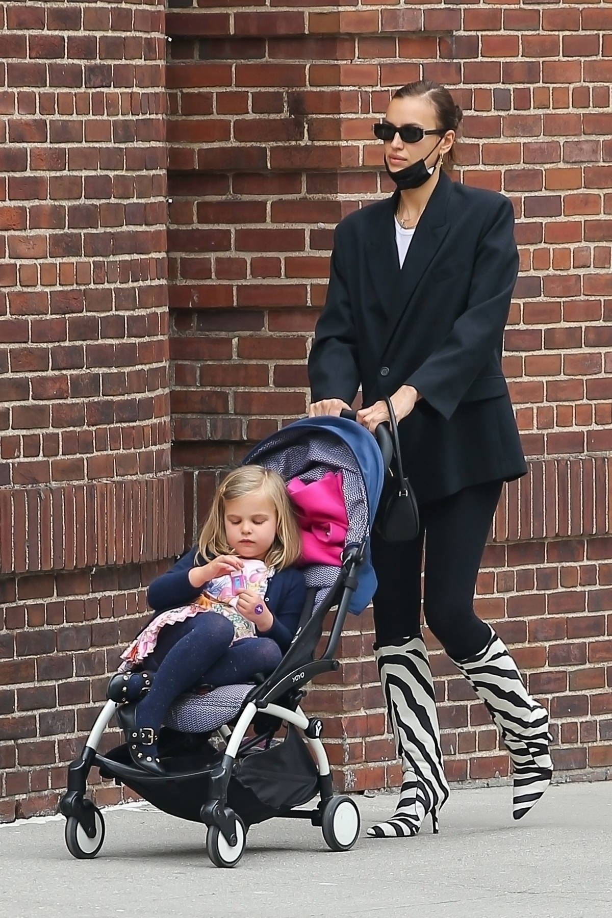 Irina Shayk puts on a stylish display while she picks up her daughter from school in New York City