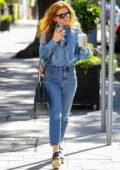 Isla Fisher looks great in double denim while making a coffee run at White Rabbit café in Double Bay, Sydney, Australia