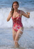 Isla Fisher wears a pink floral print swimsuit as she hits the beach in New South Wales, Sydney, Australia