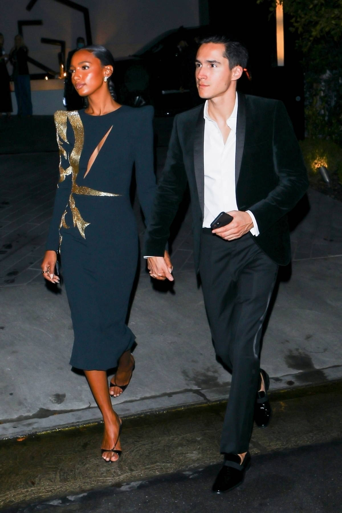 Jasmine Tookes and her fiancé Juan David Borrero seen leaving an Oscars afterparty in Bel Air, California